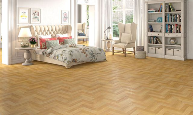 Bedroom with herringbone parquet laminate floor