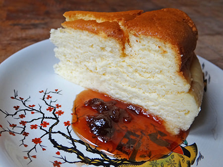 Slice of Japanese cheesecake with preserve