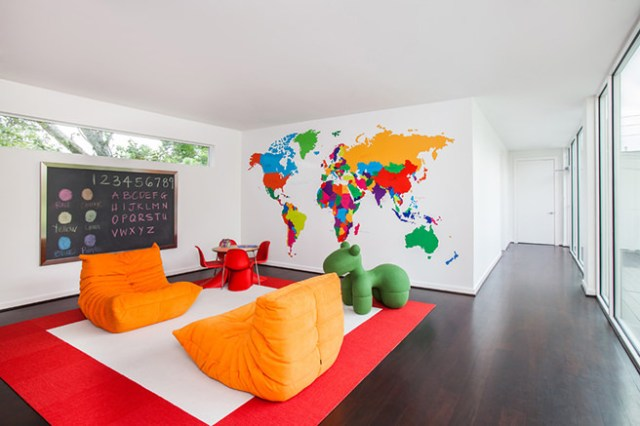 Colourful children's area with world map mural
