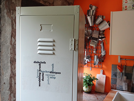 Renovated vintage industrial locker now storing cleaning items in the kitchen