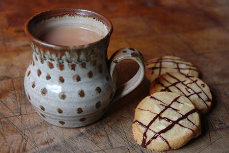 Home-made marzipan refrigerator cookies and mug of tea | via @hisforhome