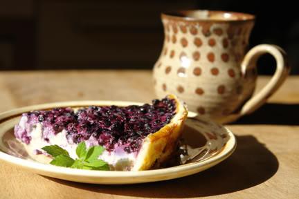 Slice of bilberry custard tart with mug of tea | H is for Home
