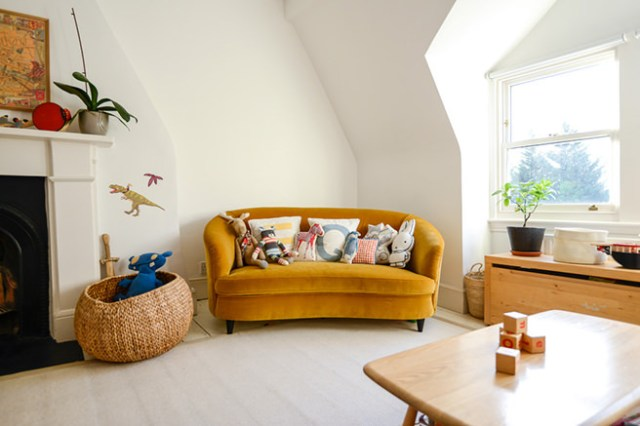 Sitting room with mustard velvet sofa in a family-friendly designed home