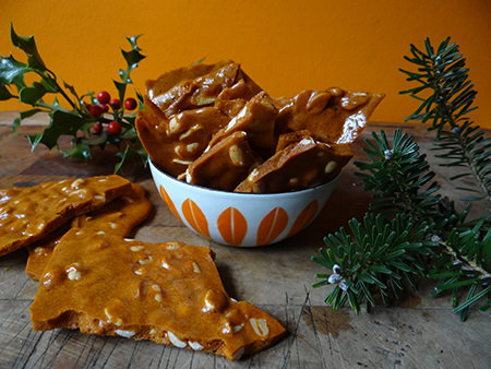 Home made peanut brittle in a vintage Cathrineholm Lotus bowl with sprigs of holly and fir to decorate | H is for Home