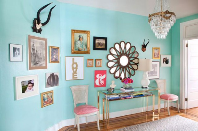 Picture gallery on a Tiffany blue painted wall
