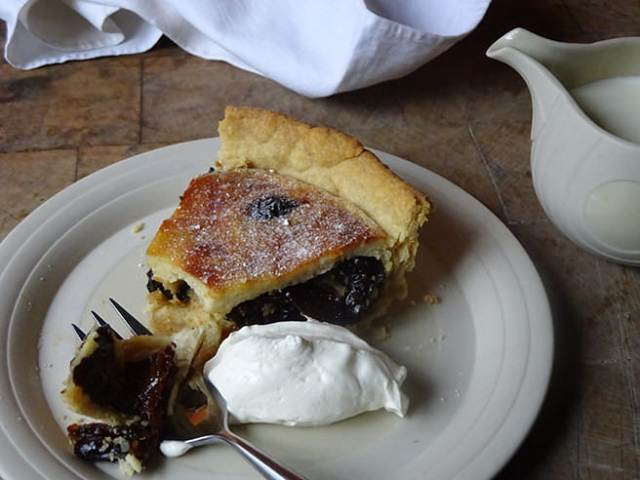Slice of home-made prune and almond tart with Armagnac with a dollop of crème fraîche | H is for Home
