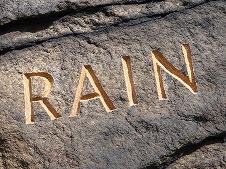 detail of Simon Armitage's 'Rain' poem carved into rock at Cow's Mouth Quarry, near Blackstone Edge on the West Yorkshire/Greater Manchester border | H is for Home