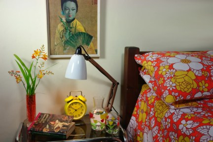 bedroom setting with Whitefriars vase designed by Geoffrey Baxter on a bedside table