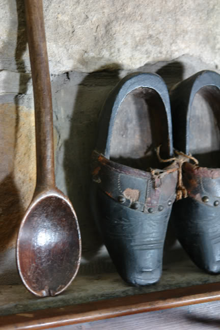 vintage wooden spoon with small antique clogs on mantlepiece | H is for Home