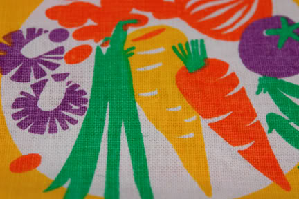 Vintage teatowel detail showing fruit & vegetable illustration