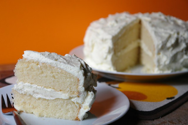 Slice of home-made white velvet cake with creamy mascarpone frosting | H is for Home