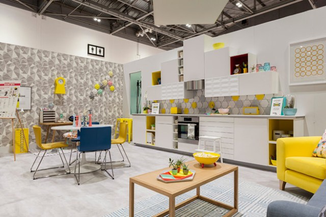Yellow-themed kitchen diner show home