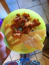 Theo's dinner: beans and rice with tortilla chips and avocados