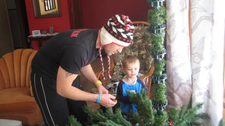 Daddy and Theo decorating. 2013.