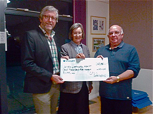 Presenting a cheque to Histon and Impington Feast to be used for supporting local groups in the community.