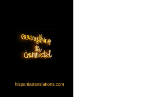 "Black background with yellow neon sign saying ""everything is connected"""