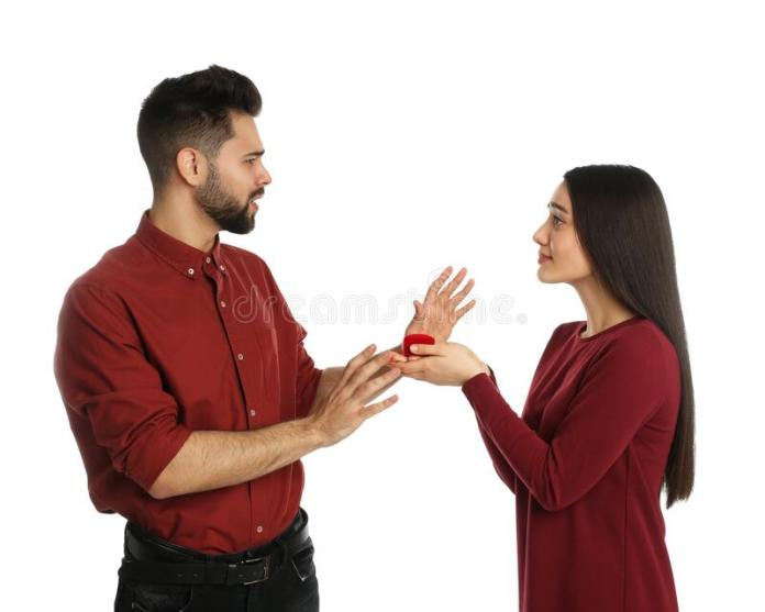 young man rejecting engagement ring girlfriend white background 174440519