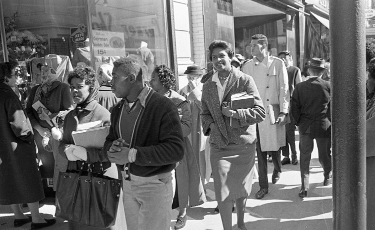 """Civil Rights protesters and Woolworth's Sit-In, Durham, NC."" Digital image. State Archives of North Carolina, Raleigh, NC. February 10, 1960. https://www.flickr.com/photos/north-carolina-state-archives/24521501625/."