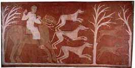 Cacería de liebres. Las liebres representan la espiritualidad del alma, y acosadas por un jinete con tridente (el demonio) en su huida por el bosque, caerán en una trampa en forma de red, representación de lo maléfico. Pintura románica de la ermita de San Baudelio de Berlanga, Casillas de Berlanga (Soria).