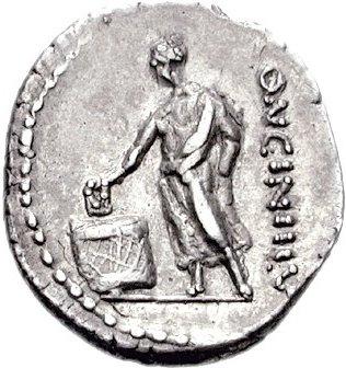 Moneda romana que representa a un ciudadano depositando su voto en una de las asambleas romanas