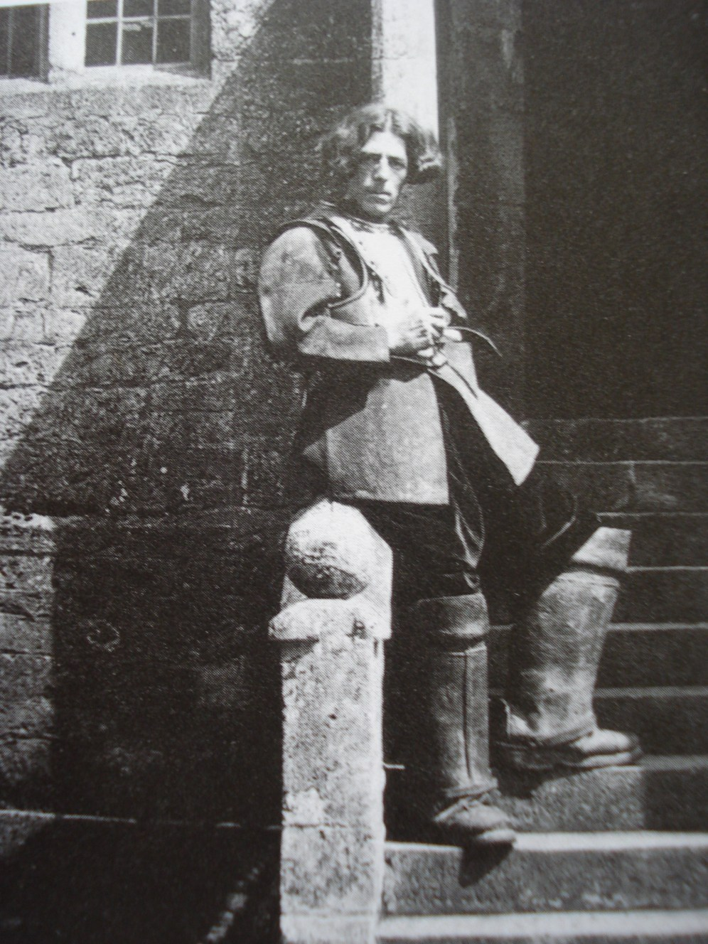 Charles Paget Wade on the steps of his Snowshill Manor in Gloucestershire