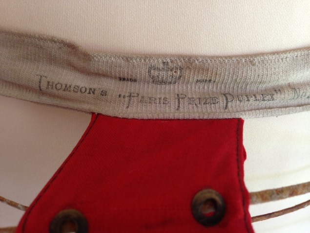Waistband stamp & Metal eyelet detail, 1870s, Snowshill Costume Collection