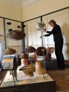 Costume Curator, Althea Mackenzie, installing the Hats & Bonnets for 'A Thousand Fancies' at Berrington Hall, Until April 30th 2014