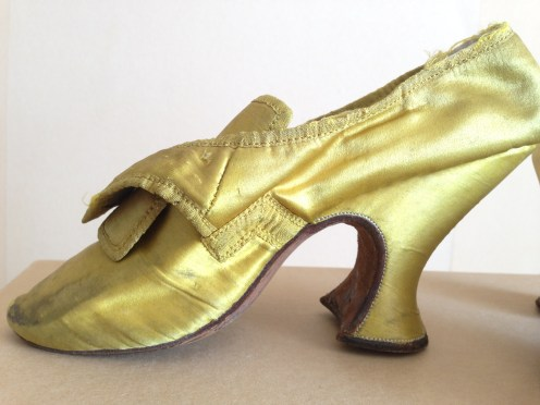 1730-50s mustard yellow satin uppers and heel covers. Charles Paget Wade costume collection, stored at Berrington Hall
