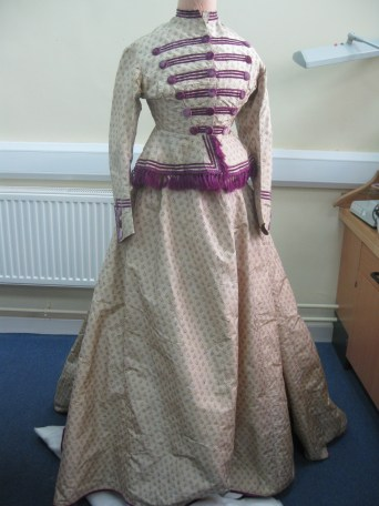 Cream and Purple silk Military Trim 1865, Hereford. Professor Nancy Hills, 'Symphony In White' exhibition at Berrington Hall throughout 2014.