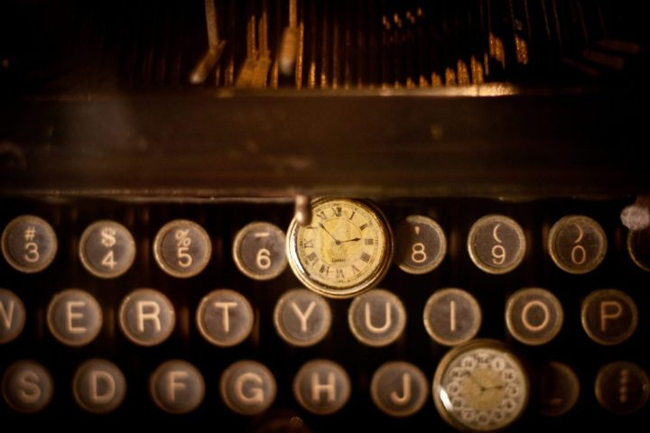 image of an antique typewriter keyboard and watch