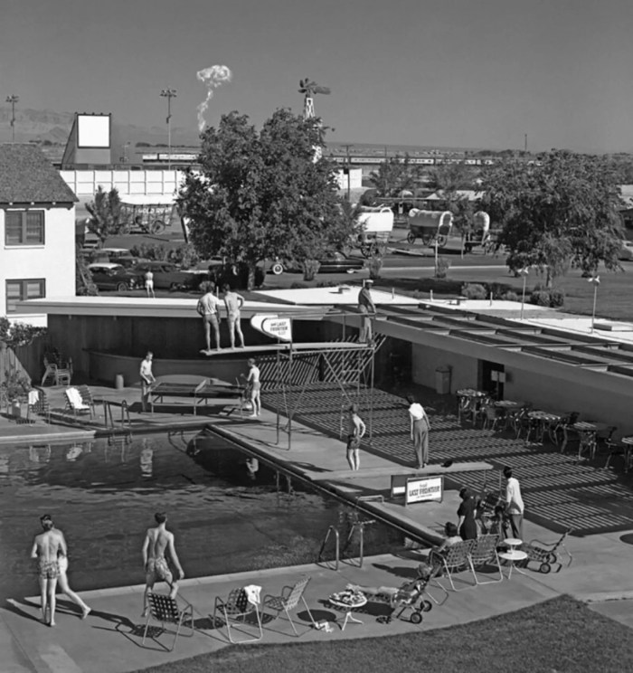 Swimmers at a Las Vegas hotel watch a mushroom cloud from an atomic test 75 miles away, 1953