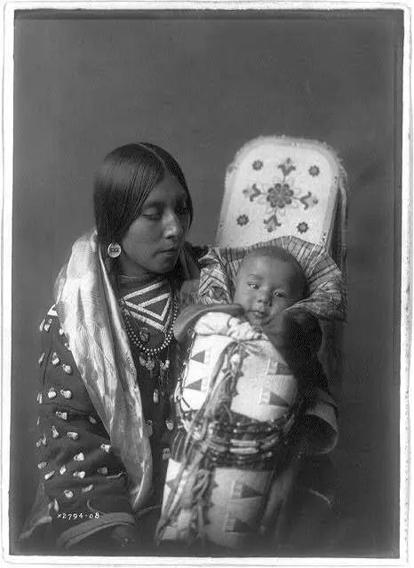 Mother and child. From the Apsaroke tribe, circa 1908.