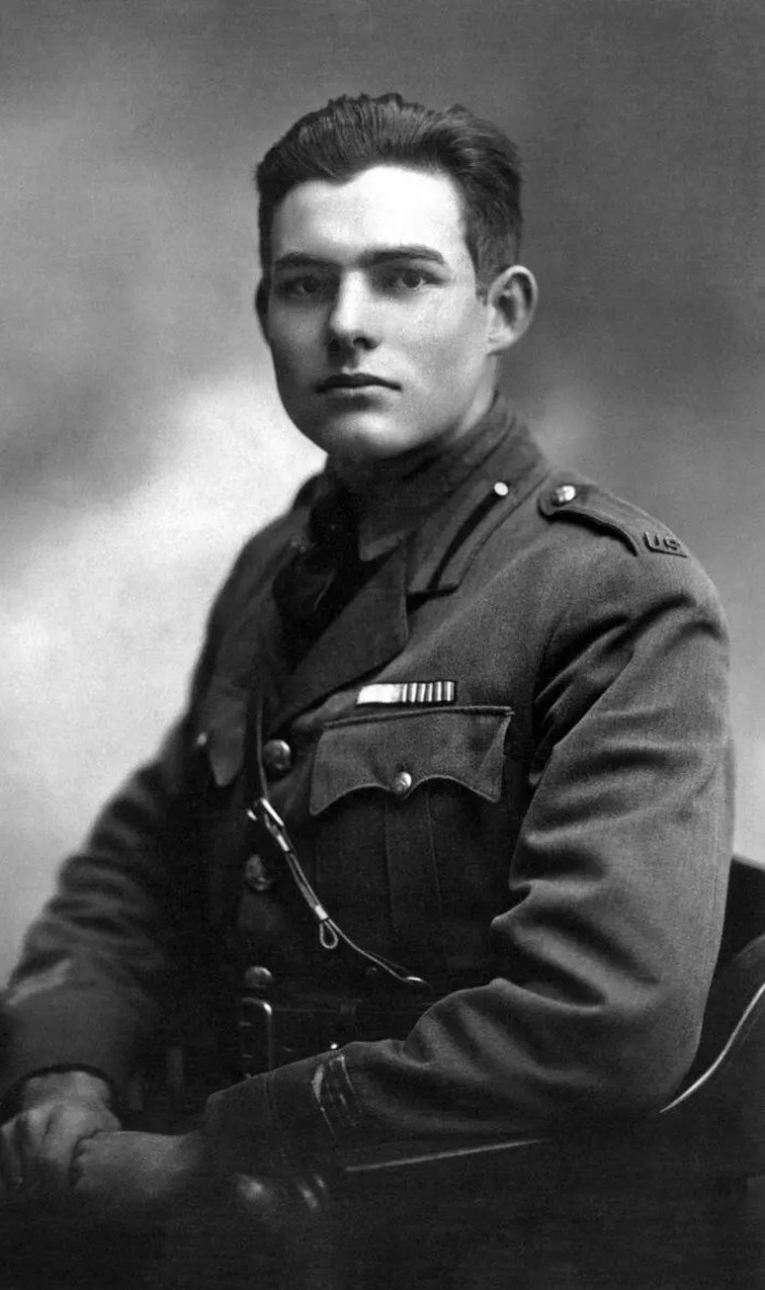 Portrait of Ernest Hemingway in uniform during WWI. Quote about living in Paris.