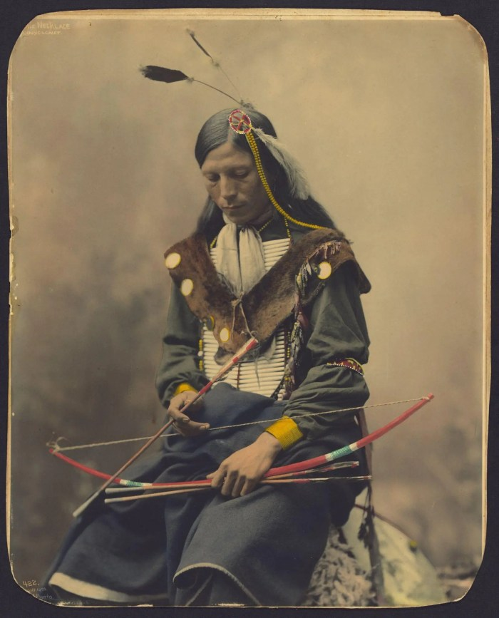 Colorized portrait of Bone Necklace, an Oglala Sioux Chief, circa 1899.