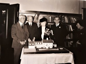 1939 Helen Keller stands behind the model of her new home Arcan Ridge, donated by Gustav Pheiffer at her immediate right