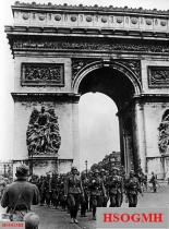 German soldiers marching past the Arc de Triomphe.