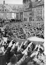 October 1938: Hitler (standing in the Mercedes) drives through the crowd in Cheb (German: Eger), part of the German-populated Sudetenland region of Czechoslovakia, which was annexed to Nazi Germany due to the Munich Agreement.