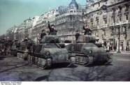 Parade of German Panzerkampfwagen 35S 739(f) in the street of Champs-Elysées, Paris, 1 January 1941. This ex-French tanks formerly known as Somua-S-35 and Hotchkiss H 38.