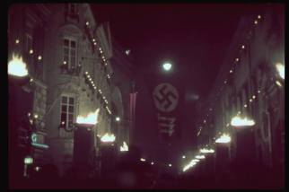 Nighttime Munich is lit with torches and festooned with swastikas in celebration of the 15th anniversary of the 1923 Beer Hall Putsch, 1938.