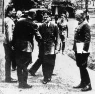 At Rastenburg on 15 July 1944. Stauffenberg at left, Hitler center, Keitel on right. The person shaking hands with Hitler is General Karl Bodenschatz, who was seriously wounded five days later, by Stauffenberg's bomb.