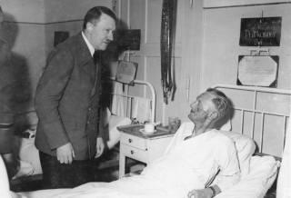 Hitler visits Admiral Karl-Jesco von Puttkamer in the hospital.