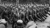 Parade of troops march thru Warsaw, Poland 1939.