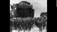 Sub - 1944: German prisoners captured at the beachhead of Anzio, South of Rome, leave a landing craft on their way to a prison camp.