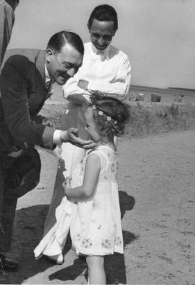 Adolf Hitler with one of Goebbels' daughters, 1933