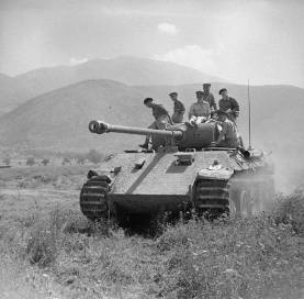 British officers ride on a captured Panther tank in Italy June 1944.