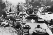 Guderian (in command vehicle) guides armoured force in Poland.