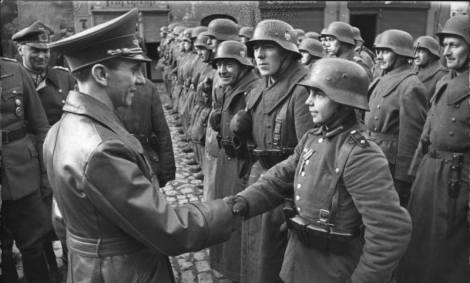 9 March 1945: Goebbels awards a 16-year old Hitler Youth, Willi Hübner, the Iron Cross for the defence of Lauban.