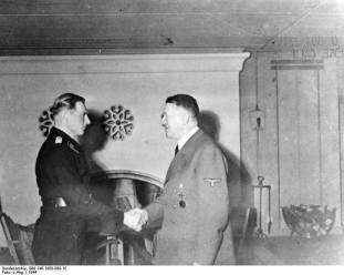 Wittmann receiving the Swords to his Knight's Cross of the Iron Cross from Adolf Hitler.