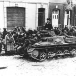 A Panzer I Ausf B on the streets of Calais, France in May 1940, while rounding up British prisoners of war.