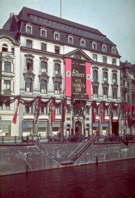 "Banners hang from buildings in honor of Adolf Hitler's 50th birthday, Berlin, April 20, 1939. The words on the banner, Wir danken dir (""We thank you""), reference a famous Bach cantata, Wir danken dir, Gott, wir danken dir (""We thank you, God, we thank you""), but are obviously addressed to Hitler."